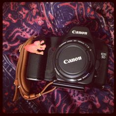 Our Hand Strap looks so good on your 5D! And so does the dino. ;) http://photojojo.com/store/awesomeness/camera-hand-strap/