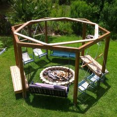 Hexagonal fire pit swingset with repurposed lawn chairs, bench swings, and fixed benches chairs ideas Outside Fire Pits, Cool Fire Pits, Diy Fire Pit, Fire Pit Backyard, Backyard Patio Designs, Backyard Projects, Backyard Landscaping, Backyard Ideas, Diy Projects