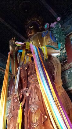 3 story Buddha in the Lama Temple: Beijing, China * Arielle Gabriel writes of her financial disaster and prayers as a Buddhist in The Goddess of Mercy & The Dept of Miracles, a book of disasters and miracles, as a mystic in a world of moneyminded Hong Kong ex-pats *