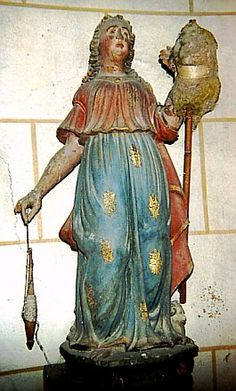 Ste Néomaye, patron saint of shepherds. French. Note what looks like wool on the distaff and an actual spindle