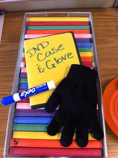Do-it-yourself mini white board using DVD container with construction paper jacket insert.....small dry erase marker to fit inside.....stretchy glove for an eraser (could also use a small piece of fleece fabric) to fit inside.