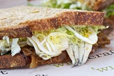 'Wichcraft    Colicchio's chain makes a solid sandwich, but our favorite is the fresh MARINATED WHITE ANCHOVY SANDWICH from the cold list, made with frisée, a soft-boiled egg, roasted onions, and salsa verde on crusty country wheat. The combination, nicely dressed with vinaigrette, is a tangy and inspired classic. $9