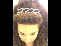 Poof and Wig tutorial- Published on Mar 16, 2014 Things you'll need: hair spray bobby pins roller pins comb teasing comb wig crown/tiara