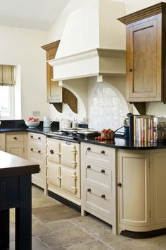 This style cooker hood and wall cabinets in wood with corbels - exactly like this.