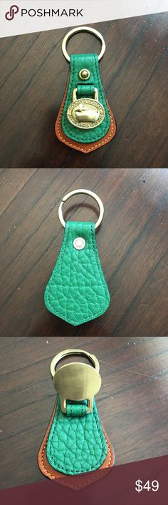 """Dooney Bourke KELLY GREEN AWL Leather Keyring FOB Rare, rare, rare vintage Kelly Green AWL for the Dooney & Bourke vintage collector. Beautiful, bright Kelly green AWL leather keychain in very good to excellent condition.  Minor blemish and dirt on the duck charm, some wear on the brass key ring itself. Measurements (approx): 4"""" long (ring included); 2"""" at widest part; 0.5"""" at thickest part. Dooney & Bourke Accessories Key & Card Holders"""