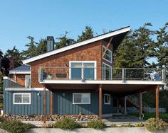 cedar shake, METAL ROOF, with a mix of regular wood panel siding. I like a good mix of textures/materials!
