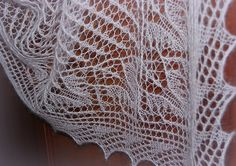 This triangular shawl begins at the bottom central tip with 3 stitches and is increased as it is worked towards the top of triangle.