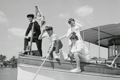 The Beatles, John Lennon, Paul McCartney, George Harrison, and Ringo Starr (left to right), on the bow of a boat in Miami Beach.