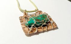 Turquoise copper and sterling silver pendant. by BerlyDesigns