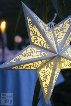 Beautiful DIY paper stars. Embellished with a tasteful amount of glitter, or covered with gossamer fabrics, these could be lovely decor accents as string light shades, centerpieces, and much more.