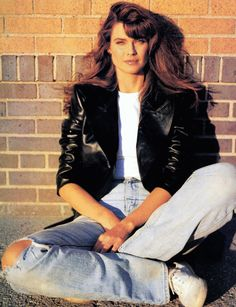 Eighties Fashion: leather jacket and ripped jeans (model: Carol Alt) uploaded by f*ckyeah1980s.tumblr.com