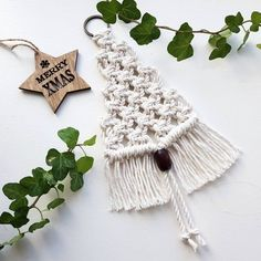 Small macrame wall pendant in the shape of a Christmas tree. The pendant is knotted from 3 mm natural cotton cord, hangs on a bronze ring and is decorated with a dark brown wooden bead. Macrame Art, Macrame Projects, Macrame Knots, Macrame Patterns, Xmas Ornaments, Yarn Crafts, Wooden Beads, Christmas Crafts, Christmas Trees