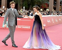 Sam Claflin takes Lily Collins' hand on the red carpet at Love, Rosie's Roman premiere on Oct. 19.