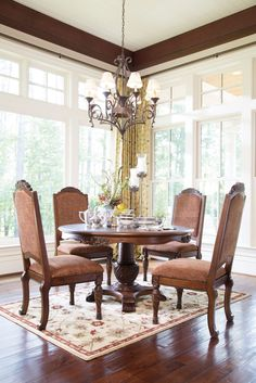 North Shore Round Pedestal Dining Room Set From Ashley Rectangular Extension Table Rooms Outlet