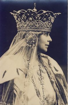 Marie of Romania wearing the steel crown forged out of a cannon captured from the Ottomans during the War of Independence.