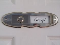 French bathroom sign to indicate when the bathroom is occupied. For WC