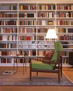Small Space Storage Ideas: Take advantage of vertical space by installing book shelves from the floor to the ceiling.