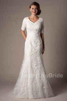 Paulista | This modest wedding dress is stunning with its magnificent lace detail! It features a soft, open v-neck with half-length sleeves and a flattering mermaid fit.     Recommended Petticoat: Trumpet    Gown available in Ivory or White.    *Gown pictured in Ivory.    LatterDayBride | Modest Wedding Dress| SLC | Salt Lake City | Utah | UT | LDS |
