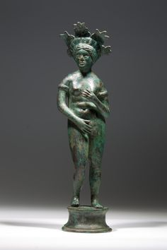 Venus of Syria.  Sizeable hollow cast bronze statuette of Venus of Syrian type in the style of the Venus de Medicis (pudique), wearing a large diadem decorated with five palmettes and a bracelet on each arm. Hellenistic Period, ca. 2nd/1st century BC.
