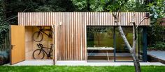 This stunning garden office with bike shed was built for a freelance photographer who required office space plus ample storage for all his kit. Cedar cladding.