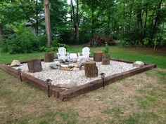 Fire pit - rail road ties, river rock and a ring. Simple and cheap!
