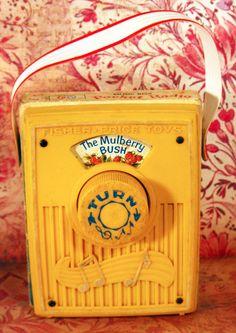 Vintage 1970 Yellow Fisher Price Baby Pocket Radio Music Box Toy - The Mulberry Bush. $10.00, via Etsy.