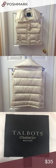 Women's Down Puffer Vest Women's beautiful satin cream-colored puffer vest by Talbots Petites. It is a petite small & is 80% down, 20% feathers. It's soft, has a large, cozy collar and bad a gold tone zipper & snaps up the front. 2 pockets outside. I only wore this once & has been hanging in my closet ever since. No stains, marks, pulls or tears. Talbots Jackets & Coats Vests
