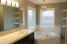 Ensuite Master Bath.  The Horizon Floor Plan. 1746 sq ft, 3 bedroom, 3 bath, two story with family and functionality in mind around every corner. Open concept on the main floor with a walk in pantry, large island, extended eating bar for food prep. The master suite has his and her sinks, custom tiled shower, corner soaker tub with tiled decking, large privacy glass windows, linen tower or floating shelves (your choice.)