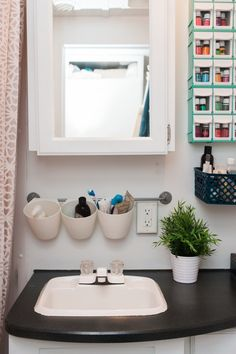 RV bathroom organization: Brittany & Jordan\'s Cozy, Modernized, DIY Cross-Country Camper