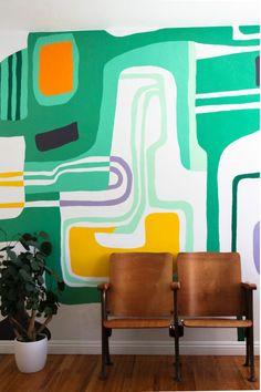 bold mural. simple vintage theater seating