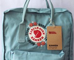 Embroidered Fjällräven Kanken Backpack There a multiple colors to choose from however be sure to mes Mochila Kanken, Kånken Rucksack, Kanken Backpack, Raven Kanken, Denim Converse, Diy Vetement, Floral Logo, Embroidery Thread, Sweater Embroidery