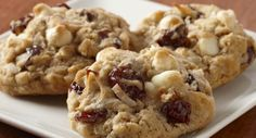 Coconut Cherry Oatmeal Cookies : This chunky cookie is full of good things - dried cherries, coconut, oats and white chocolate chips. Bake up a batch to share with your family.