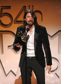Dave Grohl (in Dolce & Gabbana! yum!) at the Grammy Awards 2012.    He makes music... in a garage.