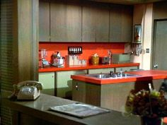 The Brady Bunch kitchen.  As an aside, I grew up with that hot orange counter myself.  One of the few stylistic gifts of 1978 design.  Still love it...