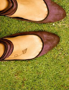 "paper airplane tattoo on right foot, ""it is finished"" small cursive in same place on left foot"