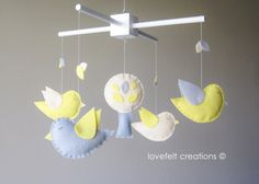 off white, gray, yellow birds with tree and leaves