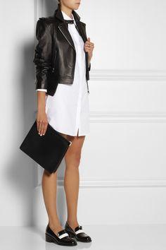 J. W. Andeson dress, Alexander Wang jacket, Maison Martin Margiela ring and clutch, Stella McCartney shoes.