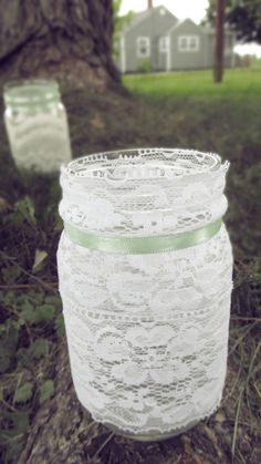 Lace Mason jars with flowers and babies breath! <3 baby shower!! Girl: pink ribbon. Boy: blue ribbon.