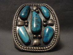 This is the best Blue Diamond turquoise bracelet we have ever seen! This piece contains five gigantic Blue Diamond turquoise stones that rest with wonderful hand carved silver fans and unique bordering beads and ropes. Turquoise Jewelry, Turquoise Stone, Turquoise Bracelet, Vintage Turquoise, Walmart Jewelry, American Indian Jewelry, Sterling Silver Bracelets, Silver Earrings, Silver Jewellery
