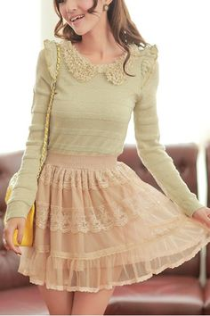 Very cute ruffled outfit with the green long sleeve blouse with the peter pan collar with the pink ruffle detailed skirt.