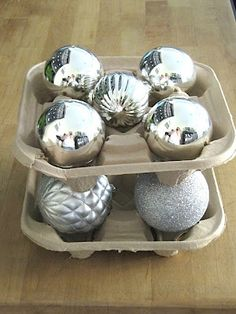 Reusing paper drinks trays to store ornaments...turn one upside down for the top layer.  This site has lots of tips.