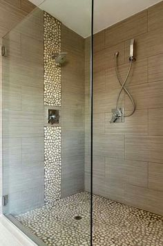 Love this more modern look to rock and tile shower. Spa shower. love this rock with the other tile.