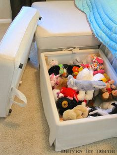 IKEA storage ottomans - perfect for hiding the ever-growing collection of stuffed animals