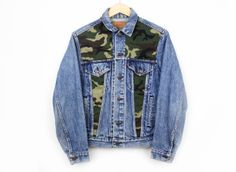 Camo oversize denim jacket. Care Instructions: Hand wash, hang to dry *Please Note: No returns accepted on outerwear* Item shows typical signs of wear including minor rips, authenticating it's age and