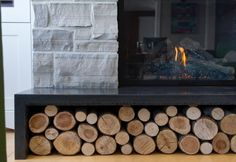 Really into the concrete fireplace surrounds featuring log storage. This really helps to create some amazing warmth and visual interest.