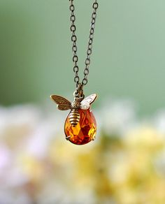 Honey Bee and Honey Drop Necklace   Crafted with a vintage, faceted, pear-shaped amber glass jewel and an antique brass bee charm. This necklace is hung on a bronze cable chain. Don't worry, the bee won't sting you. Sold on Etsy.