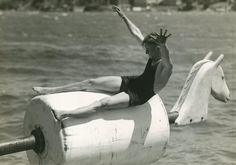 Vintage photograph 1930s: tipping horse at  Manly Harbour pool Manly, New South Wales, Australia 1930s