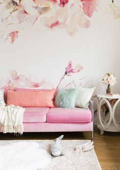 Pink flower accented wall and pink sofa: http://www.stylemepretty.com/living/2016/10/27/peek-inside-the-home-of-this-celeb-fashion-blogger-and-mama-of-two/ Photography: Nicole Gerulat