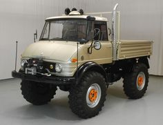 1974 Mercedes-Benz Unimog.  The Unimog is Mercedes-Benzs range of four wheel drive utility vehicles built for rough off-road environments in farming ranching and exploration.  Utility reliability ruggedness and stump-pulling power are their design attributes.