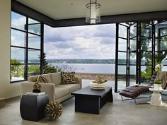 Tudor home with a modern twist on Lake Washington- love the windows and that they open. And that view!